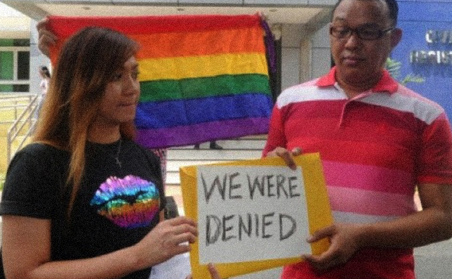 "Fr. CJ Agbayani Jr. of the LGBTS Christian Church (at right) and Arlyn ""Sugar"" Ibanez outside of Manila's Civil Registry on 3 August 2015"