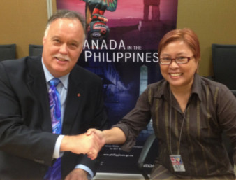 Neil Reeder, Canada's ambassador to the Philippines, with R-Rights' Angie Umbac